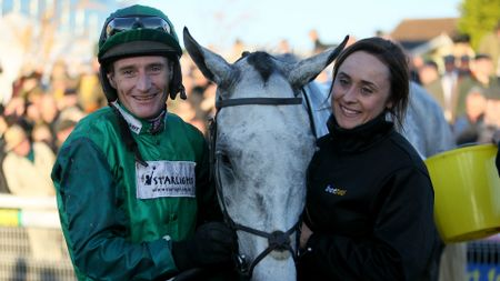 Bristol De Mai with his lass and jockey Daryl Jacob after winning the Charlie Hall Chase