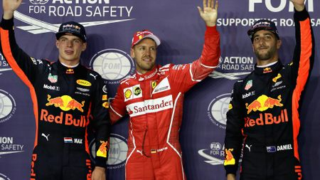 Sebastian Vettel is flanked by Max Verstappen and Daniel Ricciardo