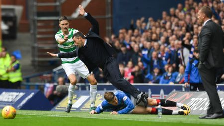 Rangers manager Pedro Caixinha is taken out by Josh Windass