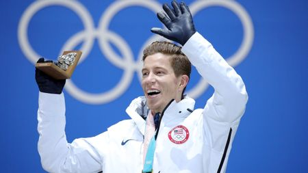 Shaun White celebrates with his gold medal