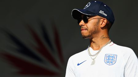 Lewis Hamilton sports an England shirt after securing pole position at Silverstone