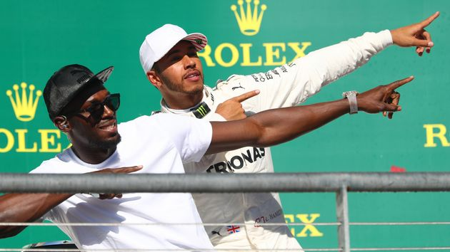 Usain Bolt and Lewis Hamilton celebrate