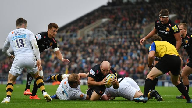Shaun Malton of Exeter Chiefs dives over to score