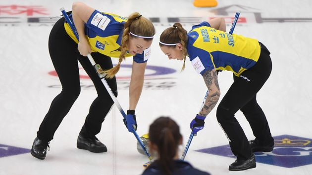 Sweden curling team in action against Great Britain