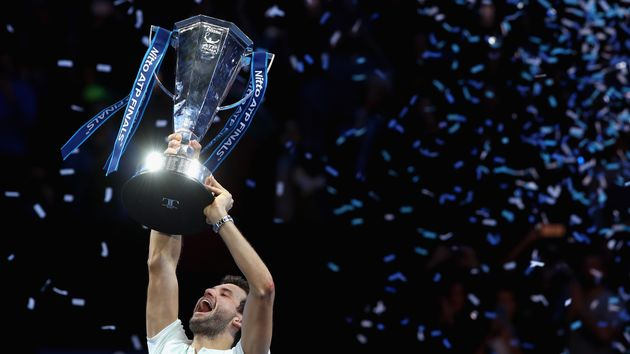 Grigor Dimitrov gets his hands on the trophy