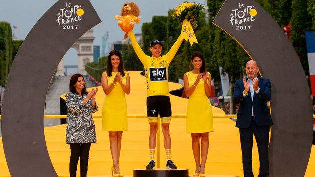 Chris Froome celebrates a fourth Tour de France