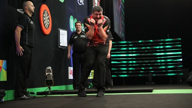 Mensur Suljovic celebrates winning the Champions League of Darts (Lawrence Lustig, PDC)