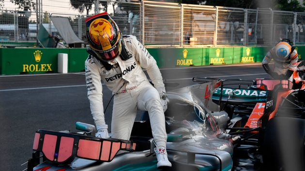 Lewis Hamilton climbs out of his car in Baku