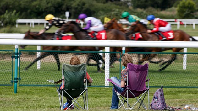 Racegoers enjoy the action at Sandown
