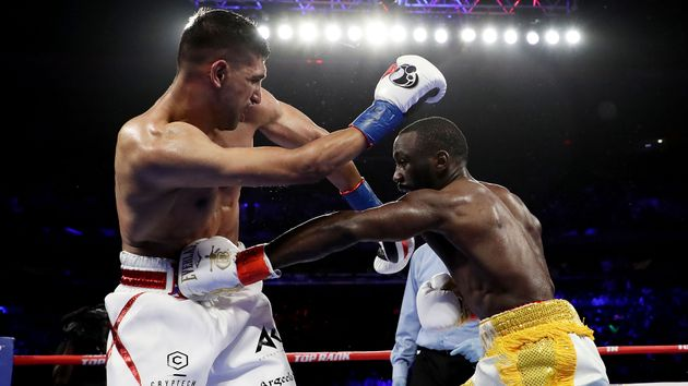 Terence Crawford punches Amir Khan during their WBO welterweight title fight