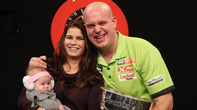 Michael van Gerwen celebrates his victory with his family (Picture: Lawrence Lustig/PDC)
