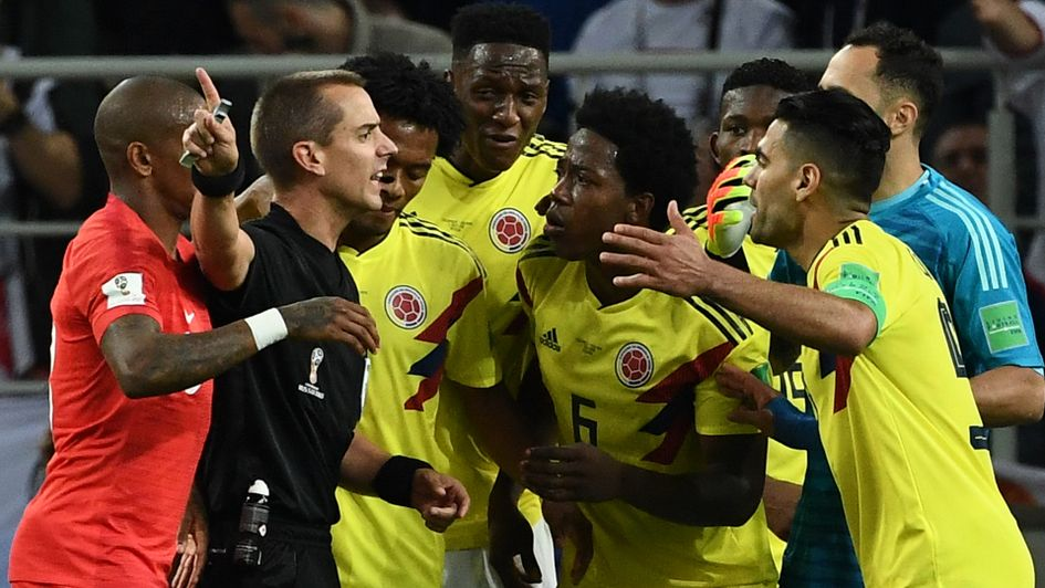 Colombia's players argue with the referee