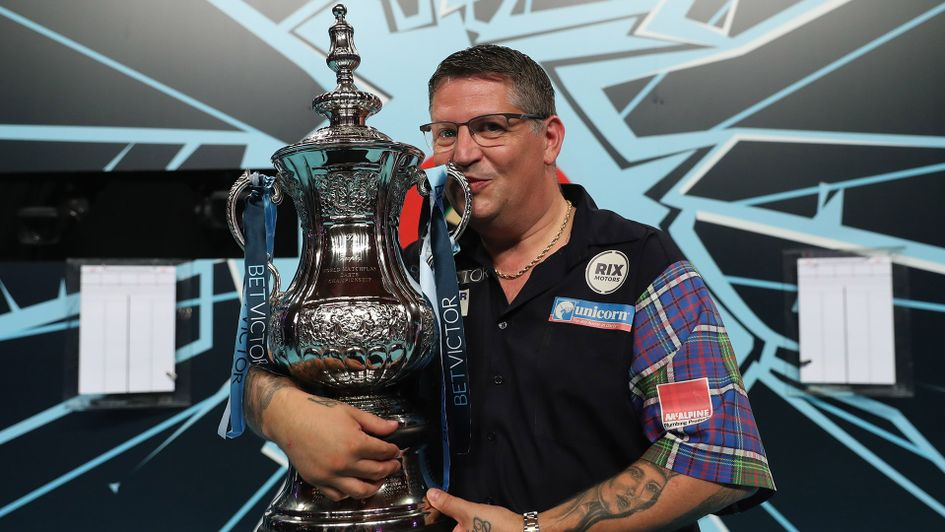 Gary Anderson kisses the Phil Taylor Trophy aloft after winning the World Matchplay (Picture: PDC/Lawrence Lustig)