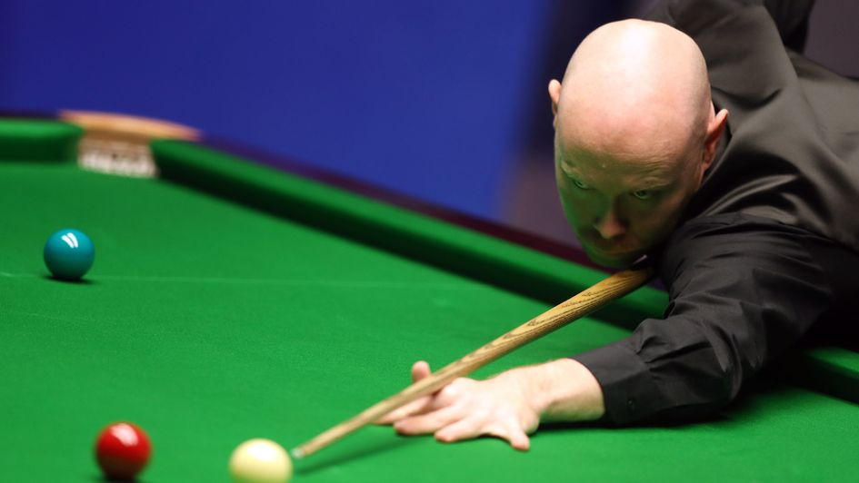 Gary Wilson in action against Judd Trump