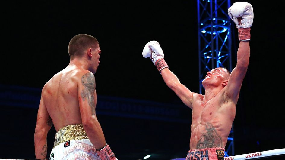 Josh Warrington (right) celebrates his victory over Lee Selby at Elland Road