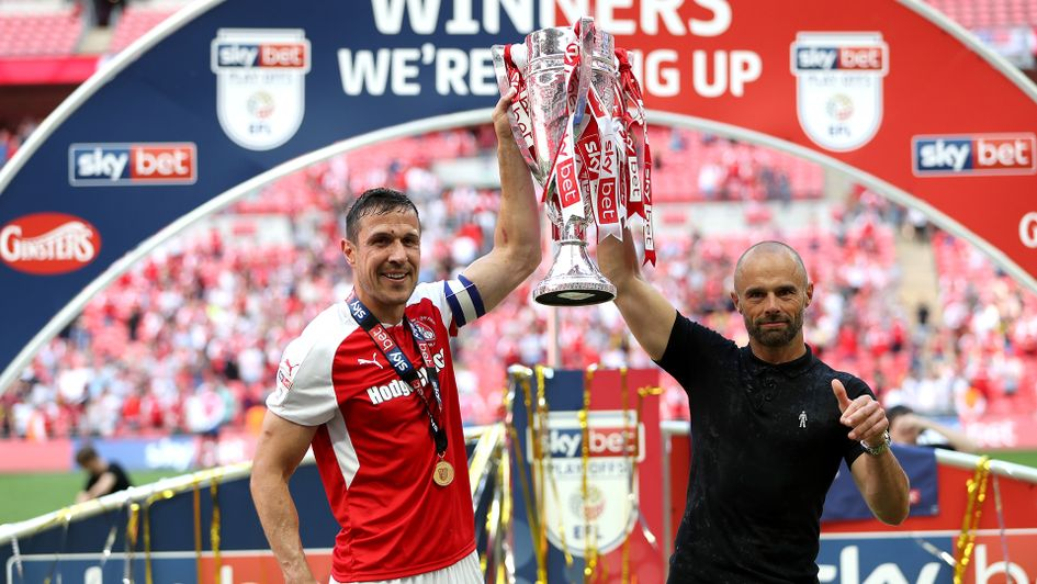 Paul Warne and Richard Wood lift the Sky Bet League One play-off trophy