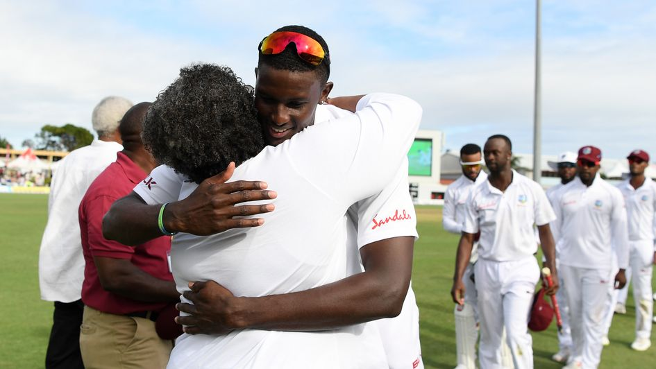 Jason Holder is congratulated by Barbados Prime Minister Mia Mottley