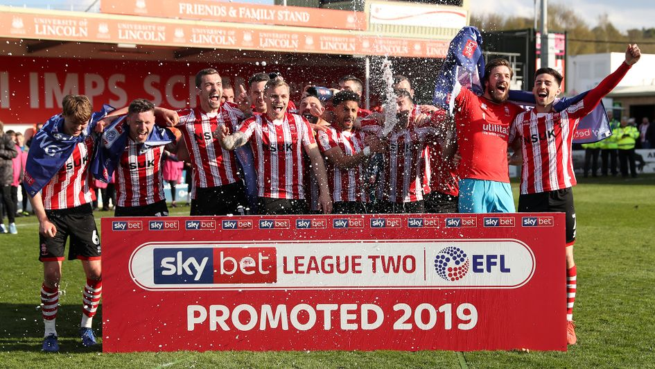 Lincoln celebrate following their promotion from Sky Bet League Two