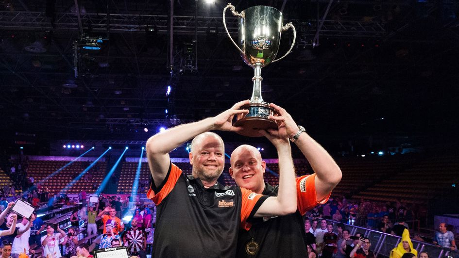 Raymond van Barneveld and Michael van Gerwen lift the World Cup of Darts trophy (Picture: Kelly Deckers/PDC)