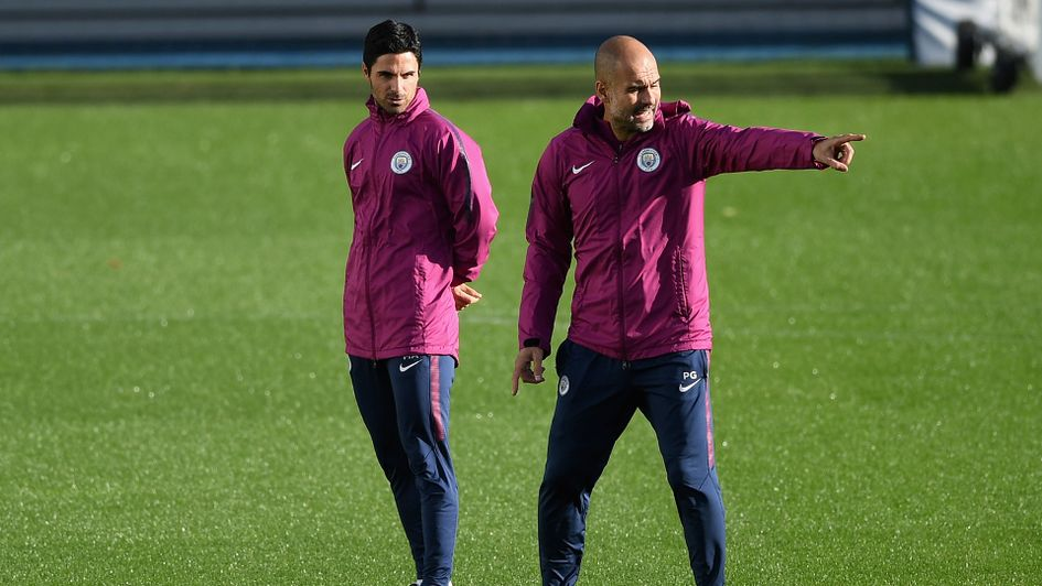 Manchester City boss Pep Guardiola (right) with assistant Mikel Arteta