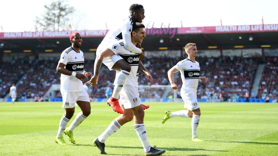 Fulham players celebrate Aleksandar Mitrovic's penalty at Bournemouth