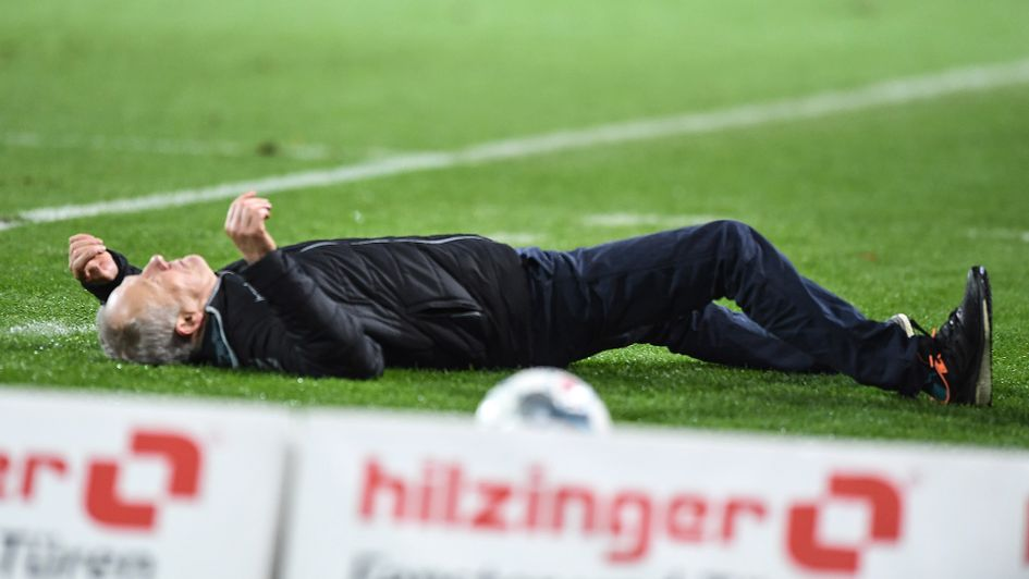 Christian Streich is barged to the floor