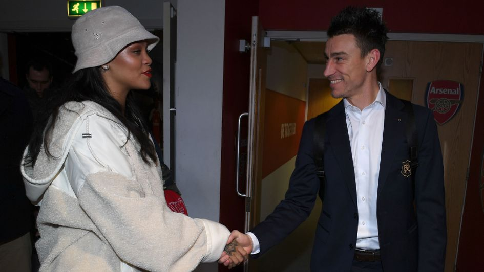 Rihanna shakes hands with Laurent Koscielny
