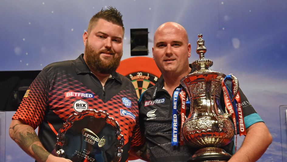 Wold Matchplay champion Rob Cross with runner-up Michael Smith (Picture: Lawrence Lustig/PDC)