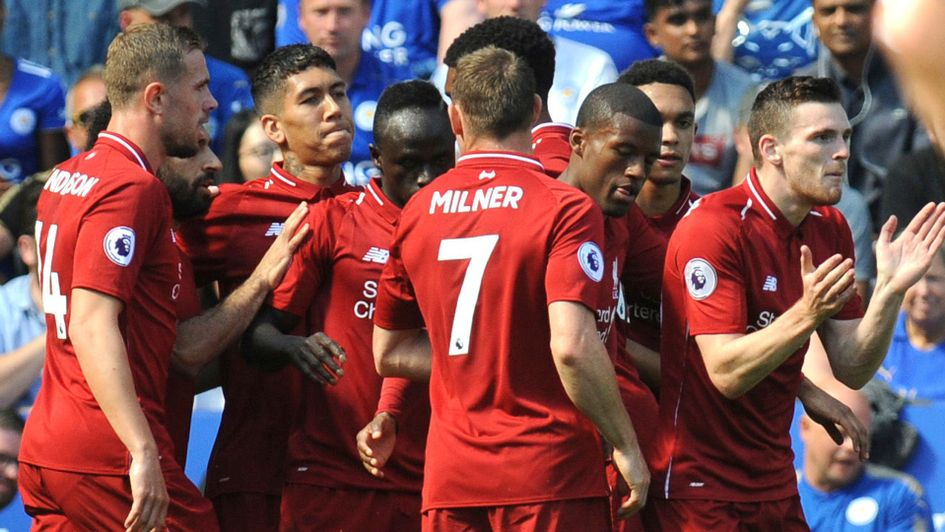 Liverpool players celebrate after scoring against Leicester