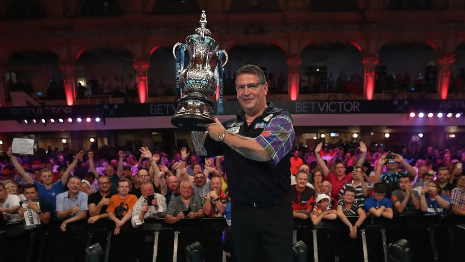 Gary Anderson lifts the Phil Taylor Trophy aloft after winning the World Matchplay (Picture: PDC/Lawrence Lustig)