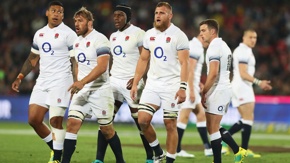 Shell-shocked: England players look on after surrendering a 21-point lead v South Africa