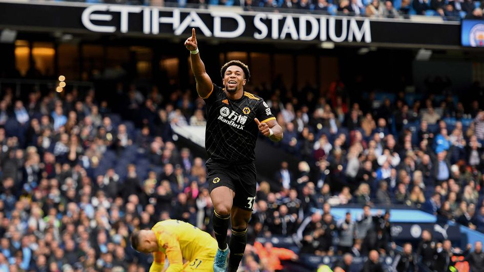 Adama Traore celebrates scoring for Wolves at Manchester City