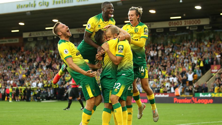 Norwich celebrate scoring their third goal against Manchester City