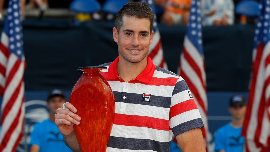 John Isner celebrates with the trophy