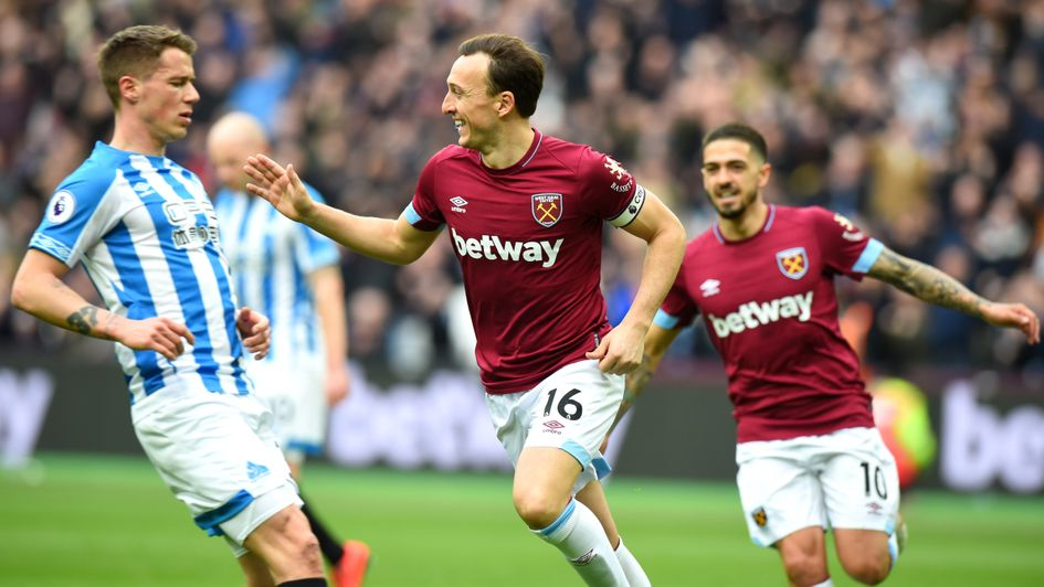 Celebrations for West Ham after Mark Noble's penalty against Huddersfield