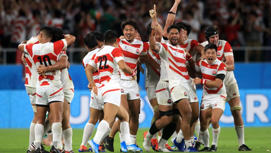 Japan celebrate their success over Ireland