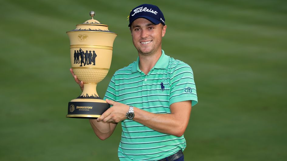 Justin Thomas poses with the Gary Player Cup after winning the World Golf Championships-Bridgestone Invitational