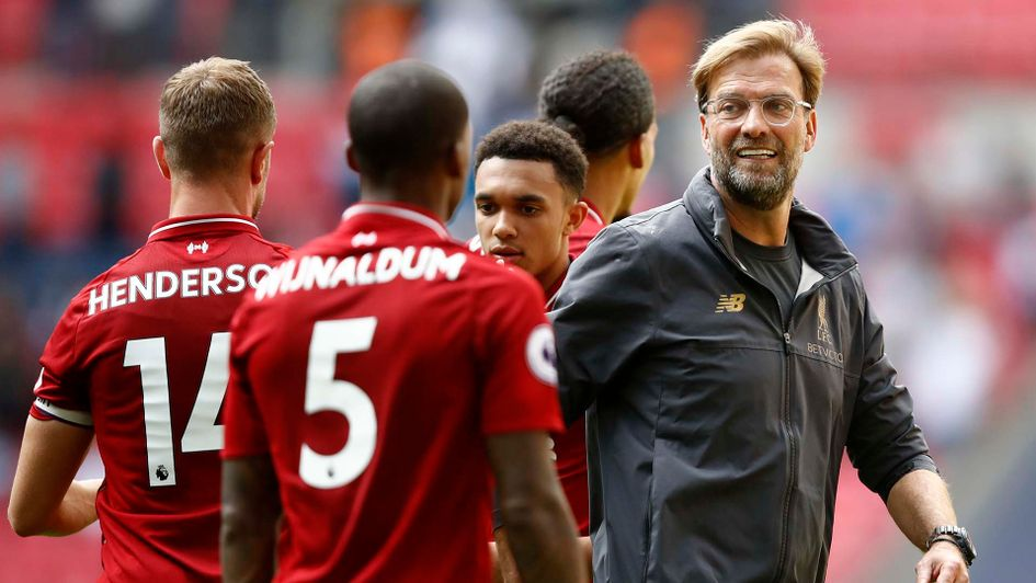 Jurgen Klopp celebrates with his Liverpool players