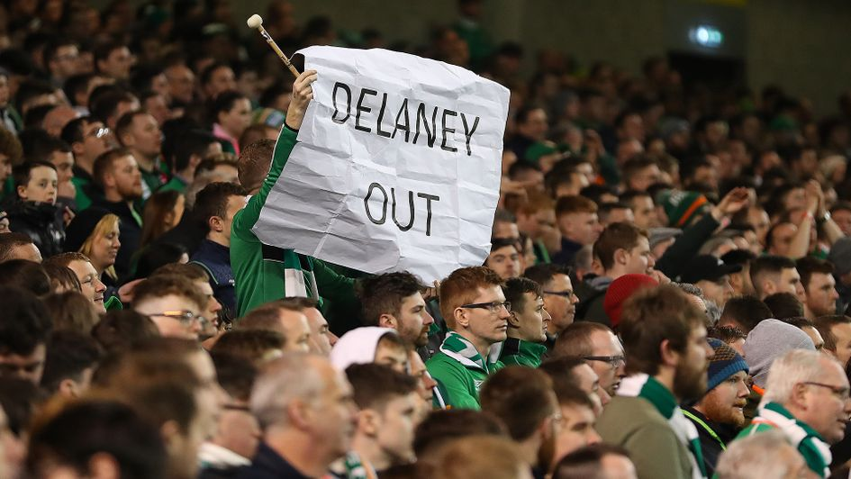 An Ireland supporter protests against Executive Vice President John Delaney