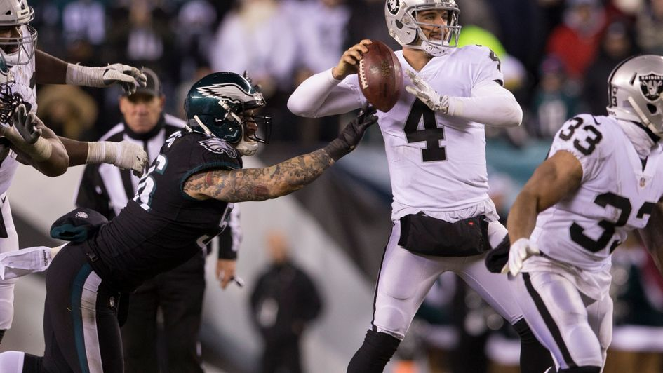 Chris Long of Philadelphia strips the ball from Derek Carr