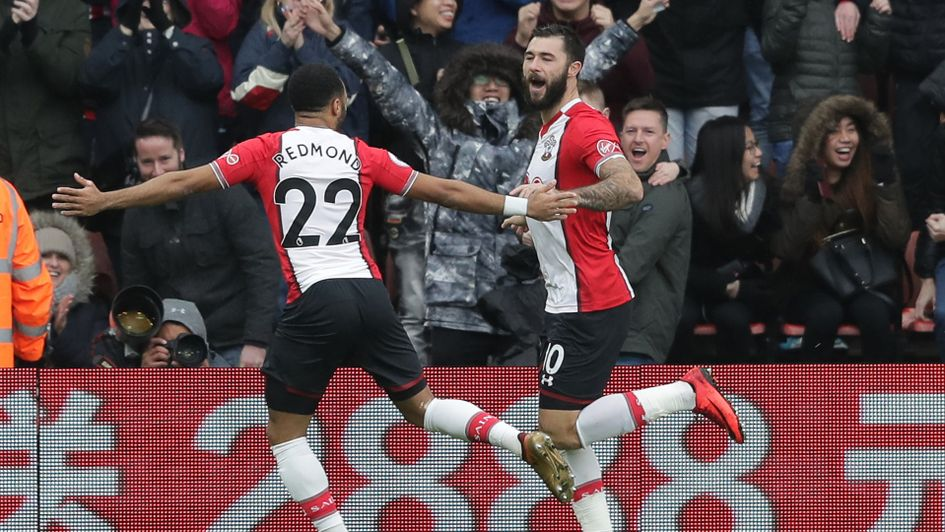 Charlie Austin celebrates his opening goal