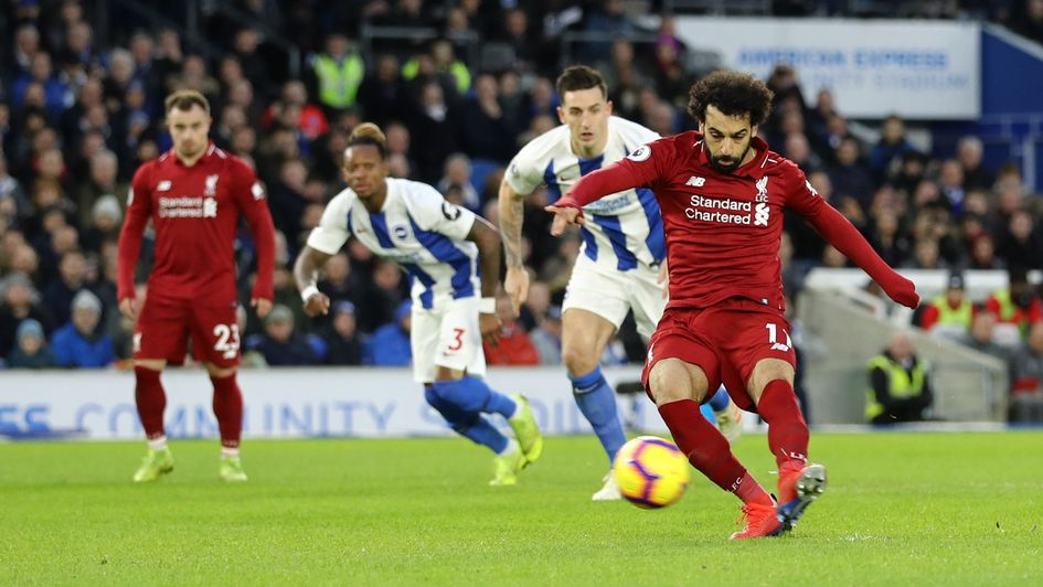 Liverpool's Mo Salah scores a penalty at Brighton