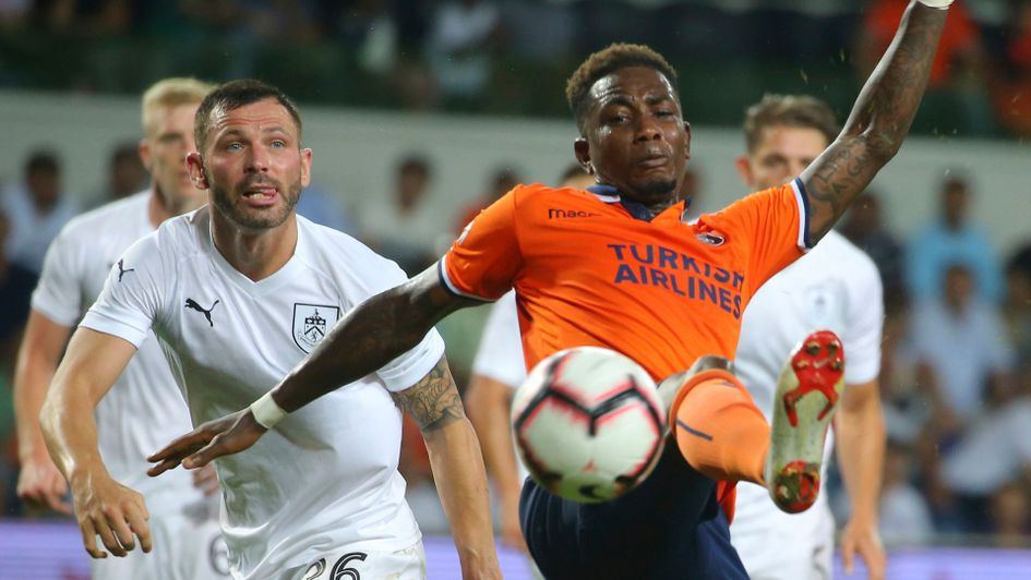 Istanbul Basaksehir's Eljero Elia tries to control the ball in front of Burnley's Phil Bardsley