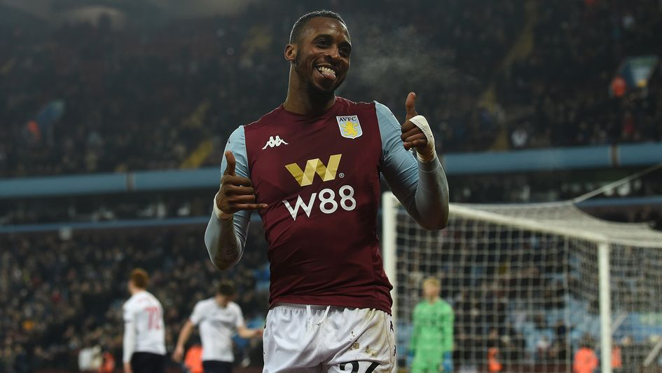Jonathan Kodjia: Aston Villa forward celebrates his hat-trick against Liverpool in the Carabao Cup