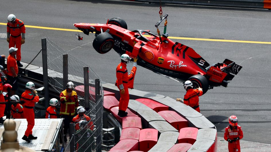 Sebastian Vettel's car is lifted from the track at Monaco