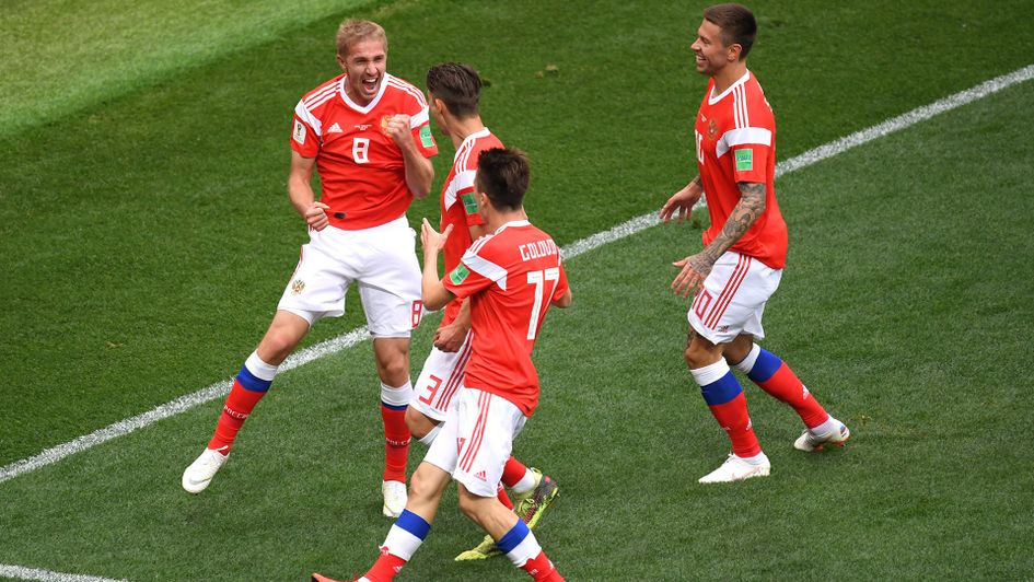 Russia's Yury Gazinsky celebrates with his team-mates after scoring the first goal of the 2018 World Cup