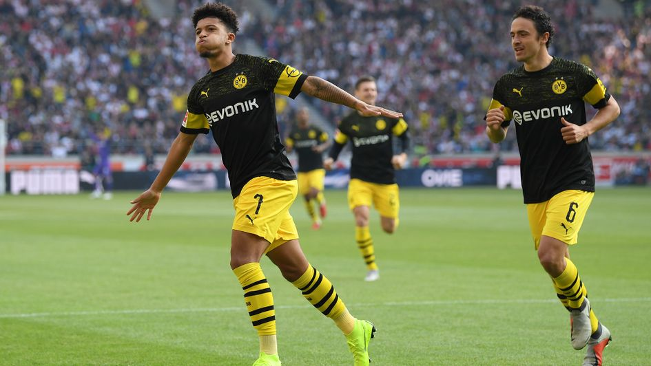 Jadon Sancho (left) celebrates after scoring against Stuttgart