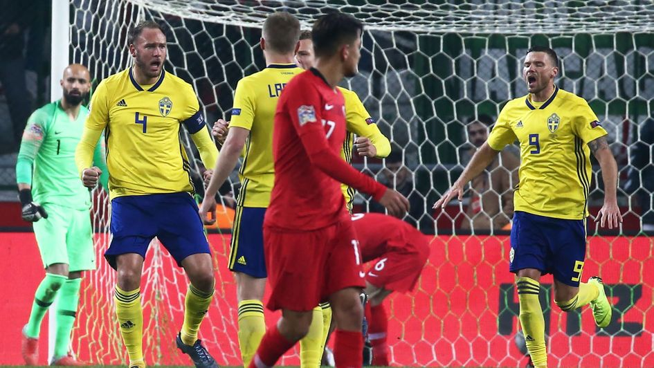 Andreas Granqvist: The Swedish veteran (left) celebrates his penalty against Turkey