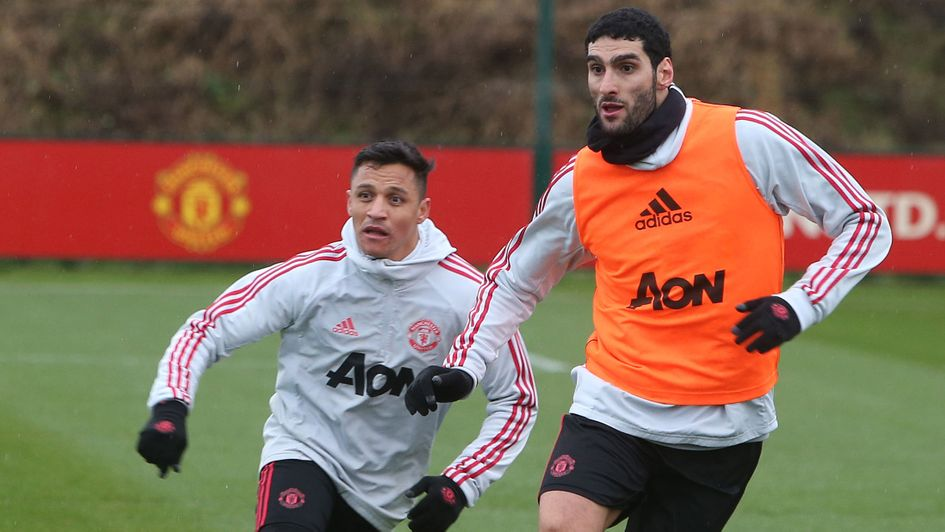 f04f73b62 Marouane Fellaini  The Belgian midfielder (right) pictured in training with  Alexis Sanchez in