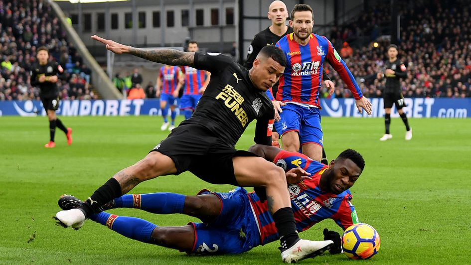 Kenedy is tackled by Timothy Fosu-Mensah